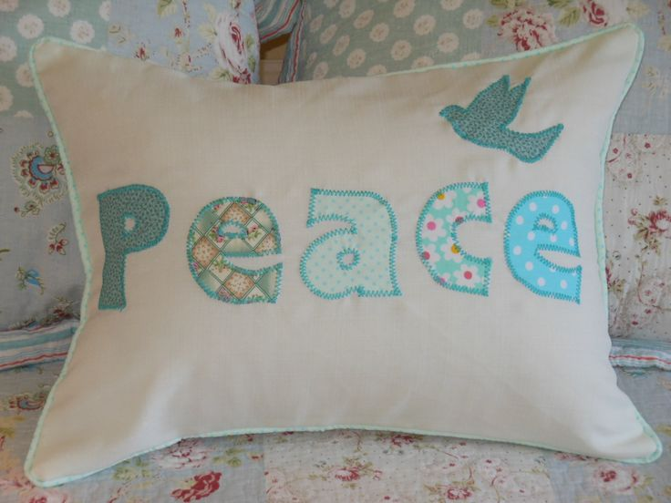 A cushion with monogram word - Peace