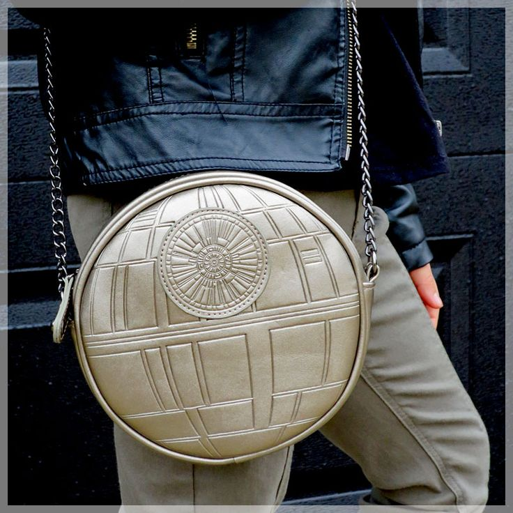 Star Wars Death Star cross body bag -- also looks great over the shoulder like this! #StarWars #Bag #DeathStar https://1923mainstreet.com/collections/star-wars/products/star-wars-death-star-cross-body-purse