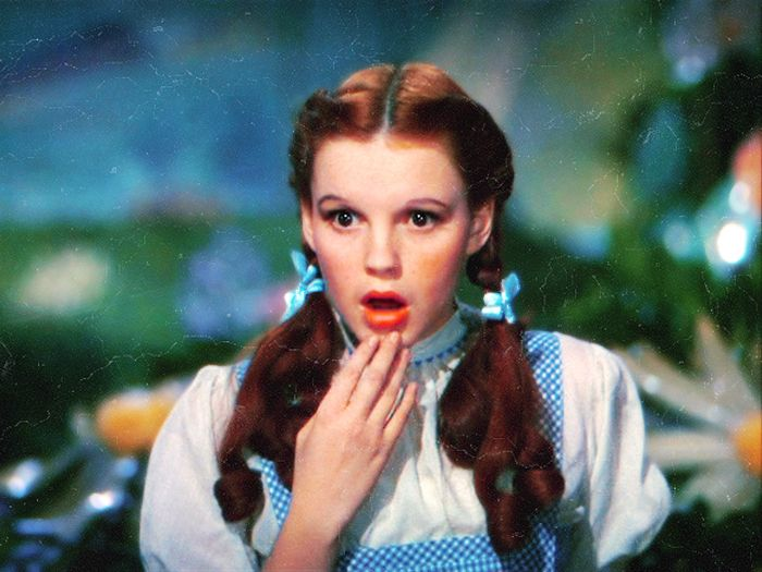 The Wizard of Oz (1939) -- I'm guessing that she's looking at the squished remains of The Wicked Witch Of The East!!