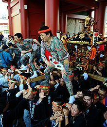 Yakuza often take part in local festivals such as Sanja Matsuri where they often carry the shrine through the streets proudly showing off their elaborate tattoos.