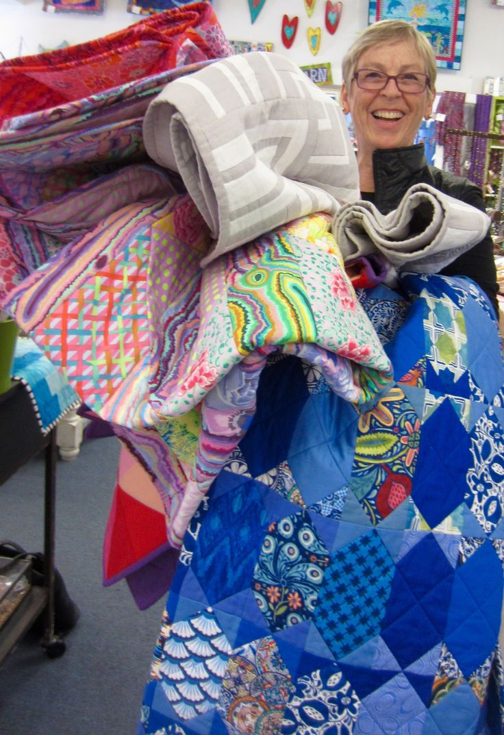 At Roxanne's in Carpinteria with a stack of quilts