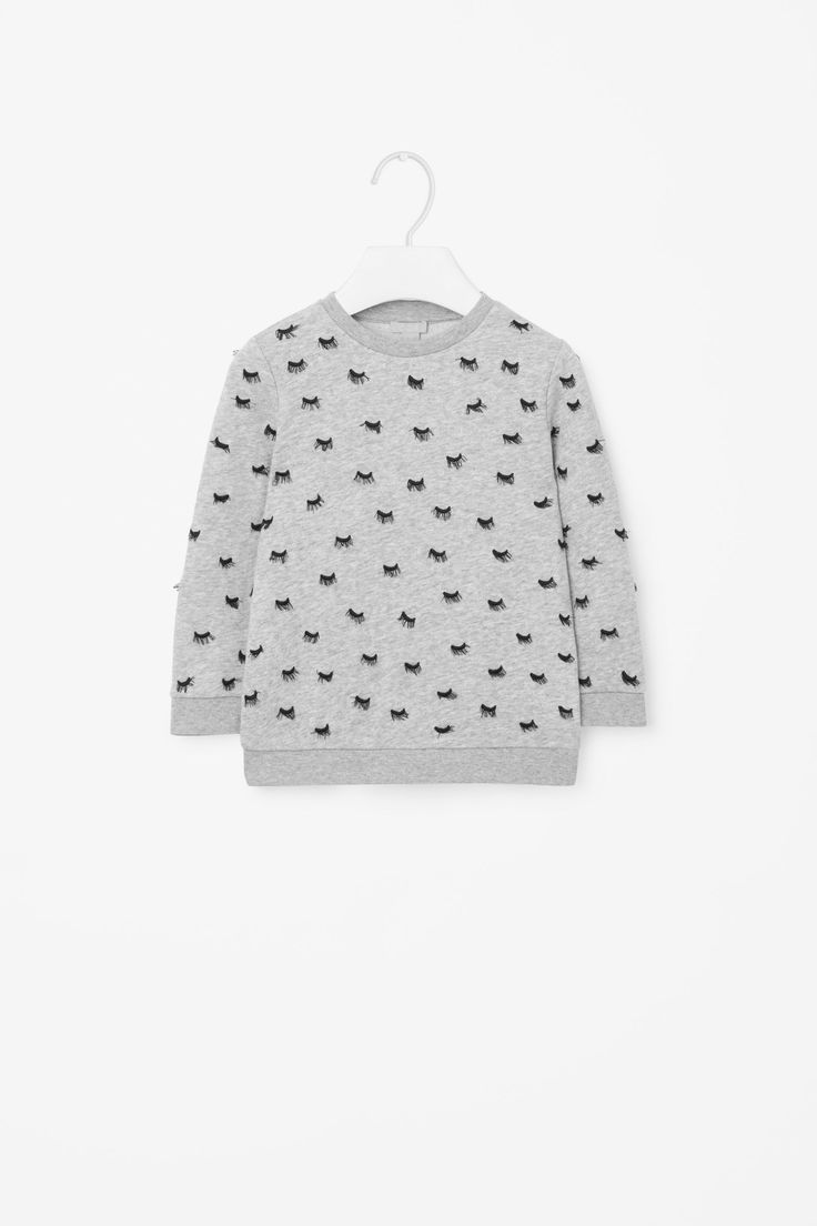Designed with an all-over stitched eyelash embroidery,  this sweatshirt is made…