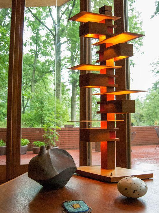 Mid Century Modern Design.  Love the lighting unit and the ceramics.