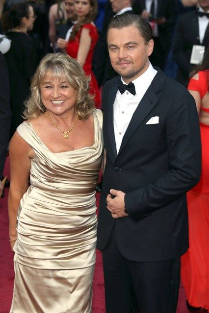 Leonardo DiCaprio leaves his Victoria's Secret girlfriend, Toni Garrn, at home and takes his mother, Iremlin, to the event instead.