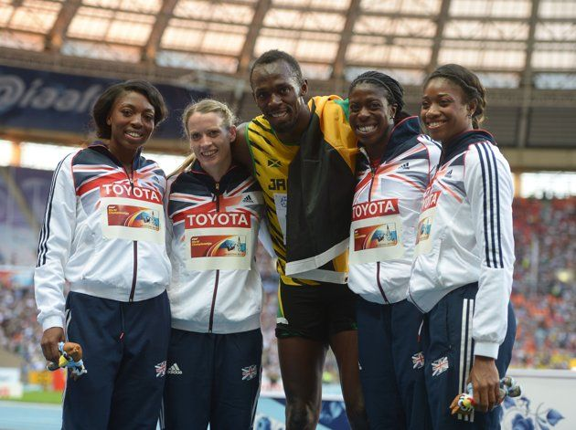 Great Britain's 4x400m Relay team (left to right) Margaret Adeoye, Eilidh Child, Christine Ohuruogu and Shana Cox who won bronze celebrate with Men's 200m Final winner Jamaica's Usain Bolt on day eight of the 2013 IAAF World Athletics Championships at the Luzhniki Stadium in Moscow, Russia.