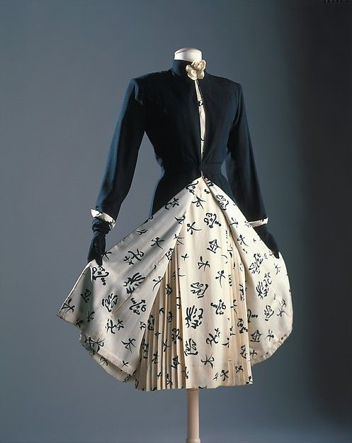 "Ensemble House of Chanel  (French, founded 1913) Designer: Gabrielle ""Coco"" Chanel (French, Saumur 1883–1971 Paris) Date: ca. 1956 Culture: French Medium: silk, wool, leather Dimensions: Length at CB (a): 48 in. (121.9 cm) Length at CB (c): 48 in. (121.9 cm) Credit Line: Brooklyn Museum Costume Collection at The Metropolitan Museum of Art, Gift of the Brooklyn Museum, 2009; Gift of H. Gregory Thomas, 1959 Accession Number: 2009.300.261a–c Ensemble"