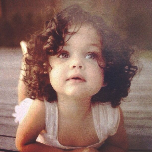 love her curls. I hope my daughter inherits my curly hair :)