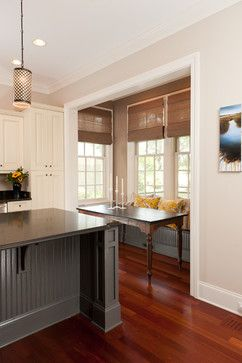 The walls are Urban Putty from Sherwin Williams and the island is Benjamin Moore Kendall Charcoal.  Pendants from The company is Architects and Heroes, the shades are from Target, The floors in this home are Brazilian Cherry