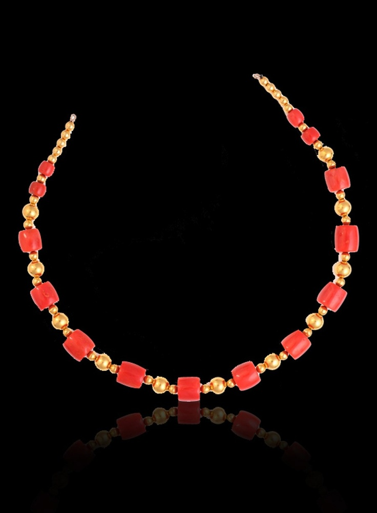 Coral beads with light weight gold balls  Red coral cylindrical beads cut in graduated sizes and separated by a sequence of gold beads. A beautiful colour combination enhanced even further by the smart and smooth flowing curves of the design.$4000