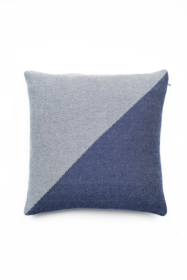 Two sided luxurious cushion in 100%cotton, woven exclusively for Lane by  London Cloth Company.  A soft to the touch cloth with a two colour diagonal weave of rope dyed  indigo with natural unbleached cotton.One side has a unique design of two  triangular panels.  Ideal for adding style, t