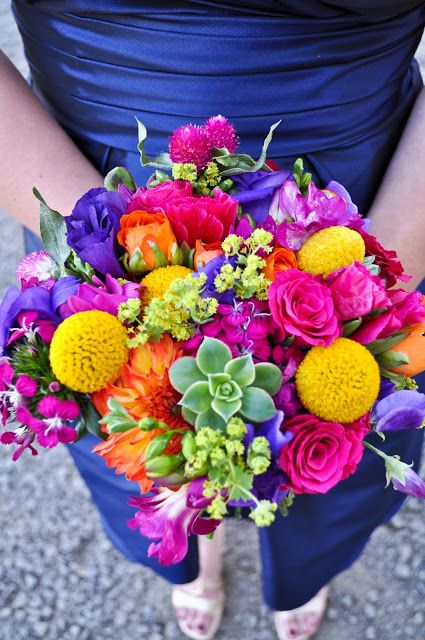 Colorful barn wedding bright bridal bouquet with yellow billy balls and succulents