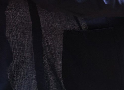 Where the jacket does not overlap, a nice breathable surface appear. The darker areas comes from two or more layers of the fabric.