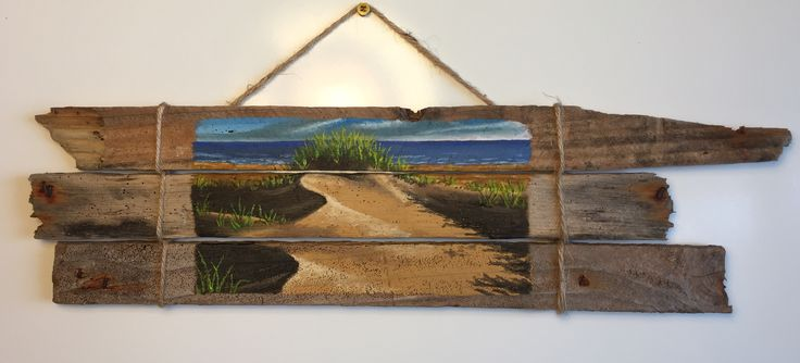 I painted a sand dune-and-ocean scene directly onto a section of old lobster trap. The slats washed up on a Prince Edward Island beach near a fishing wharf, and the found object was collected and dried as is before becoming my canvas for a PEI landscape. My mother-in-law, in fact,  collected this and shipped it along with other driftwood specifically for me to create from.