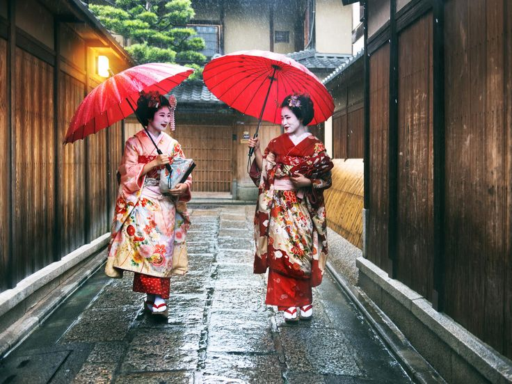 umbrella outdoor color red clothing woman person rain walking street sidewalk Nature costume spring way accessory carrying tradition rainy