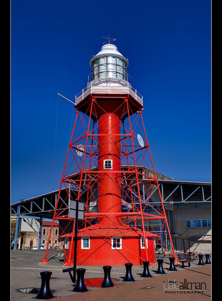 Port Adelaide Lighthouse, South Australia. It stands at the end of Commercial Road where the city meets the Port River. It was prefabricated in England from iron plates and shipped in pieces. It replaced the lightship Fitzjames which was moored at the mouth of the Port River. Visitors can climb the seventy-four steps and take in the views of Port Adelaide.