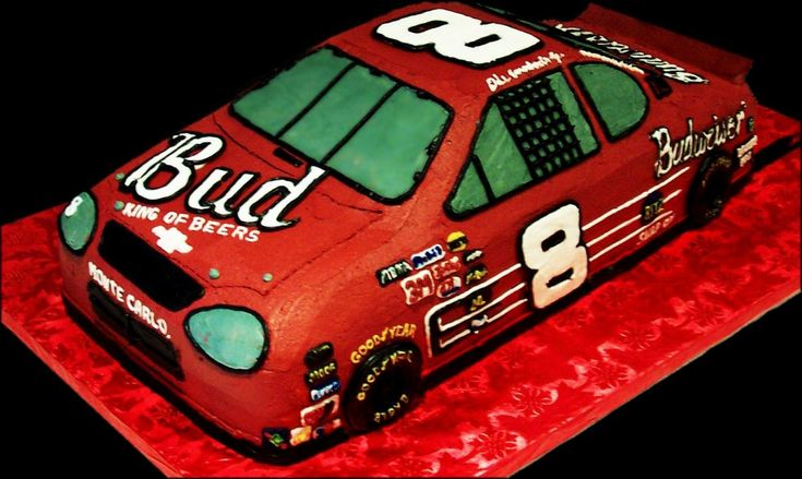 Dale Jr Race Car Birthday cake,  Red buttercream iced, shaped cake decorated with sponsors such as  Budweiser, good year, mobile  and of course the car's infamous #8. Everything on this cake is EDIBLE.