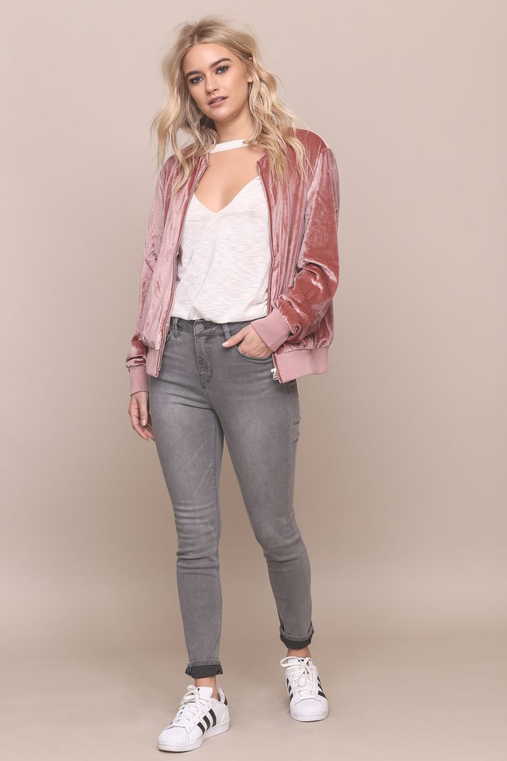 Velvet bomber jacket. Front zipper closure. Front pockets with zipper closure. Fully lined. Style #: E02840-2 Material: Polyester/Spandex Color: Pink Model is wearing a small