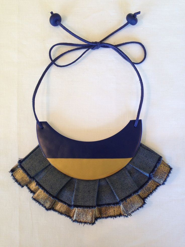 Statement necklace - navy with gold dipped feature. Linen fringing and leather details