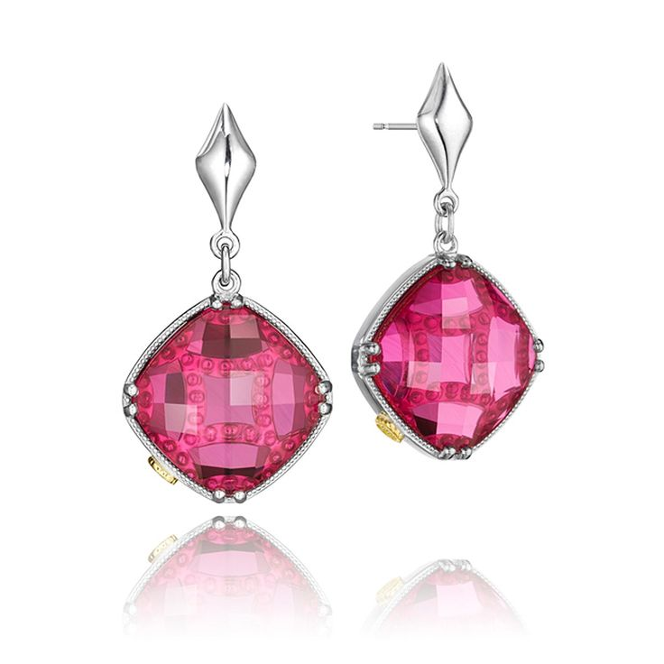 Red cushion cut stones are nestled in a bed of silver for a classic look. These stones delicately hang from a silver diamond shape and look gorgeous on the ears.