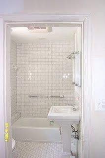 Flip layout for hall bath, replace vanity with pedestal, tile to the ceiling