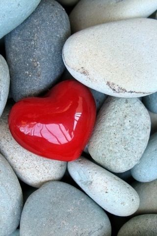 Red heart in rocks