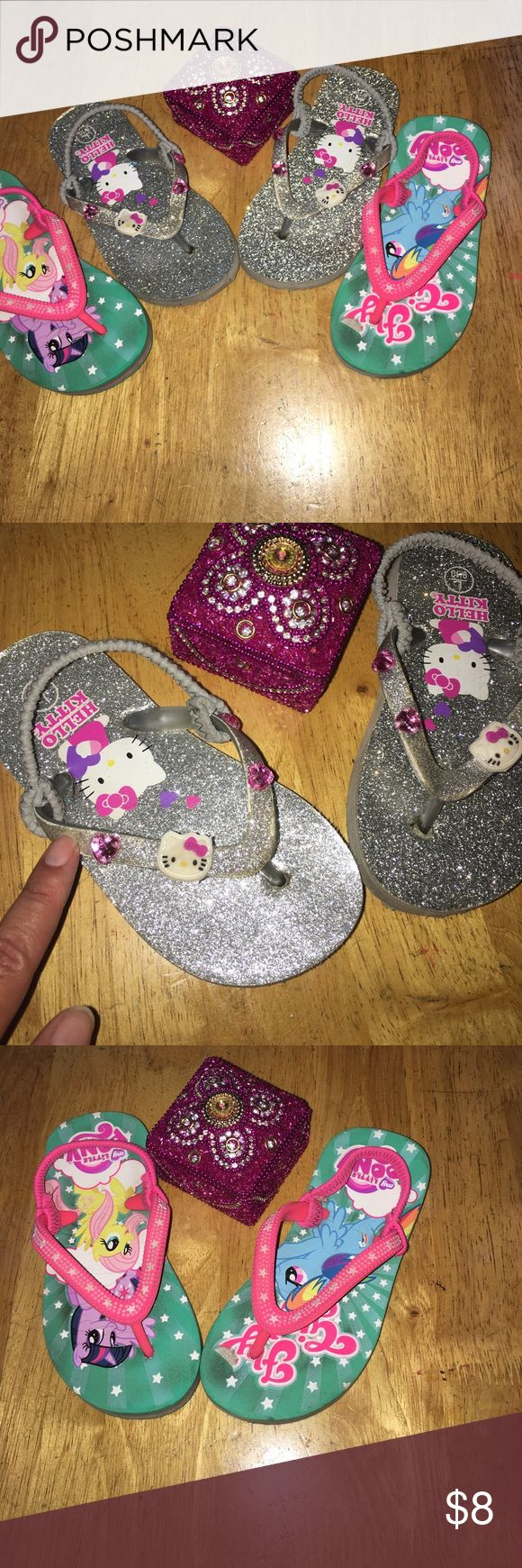 Flip flops Hello kitty sparkles flip flops has some wear on the side where my finger is pointing to my little pony have some wear also otherwise great summer sandals . Hello Kitty Shoes Sandals & Flip Flops