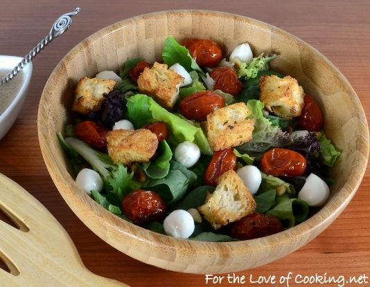 ... Greens with Roasted Tomatoes, Mozzarella Pears, and Homemade Croutons