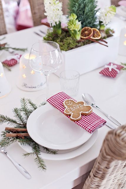 all white plates, red checkerboard napkin, with pine and cinnamon accents. + gingerbread man :):