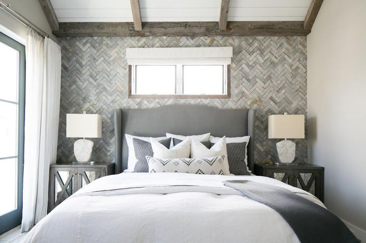 Reclaimed wood walls are hot, hot, hot! But, they can also be oh-so-cool as designer Brooke Wagner proves in this small bedroom where silvery gray boards installed in a timeless herringbone pattern create a dreamy backdrop.