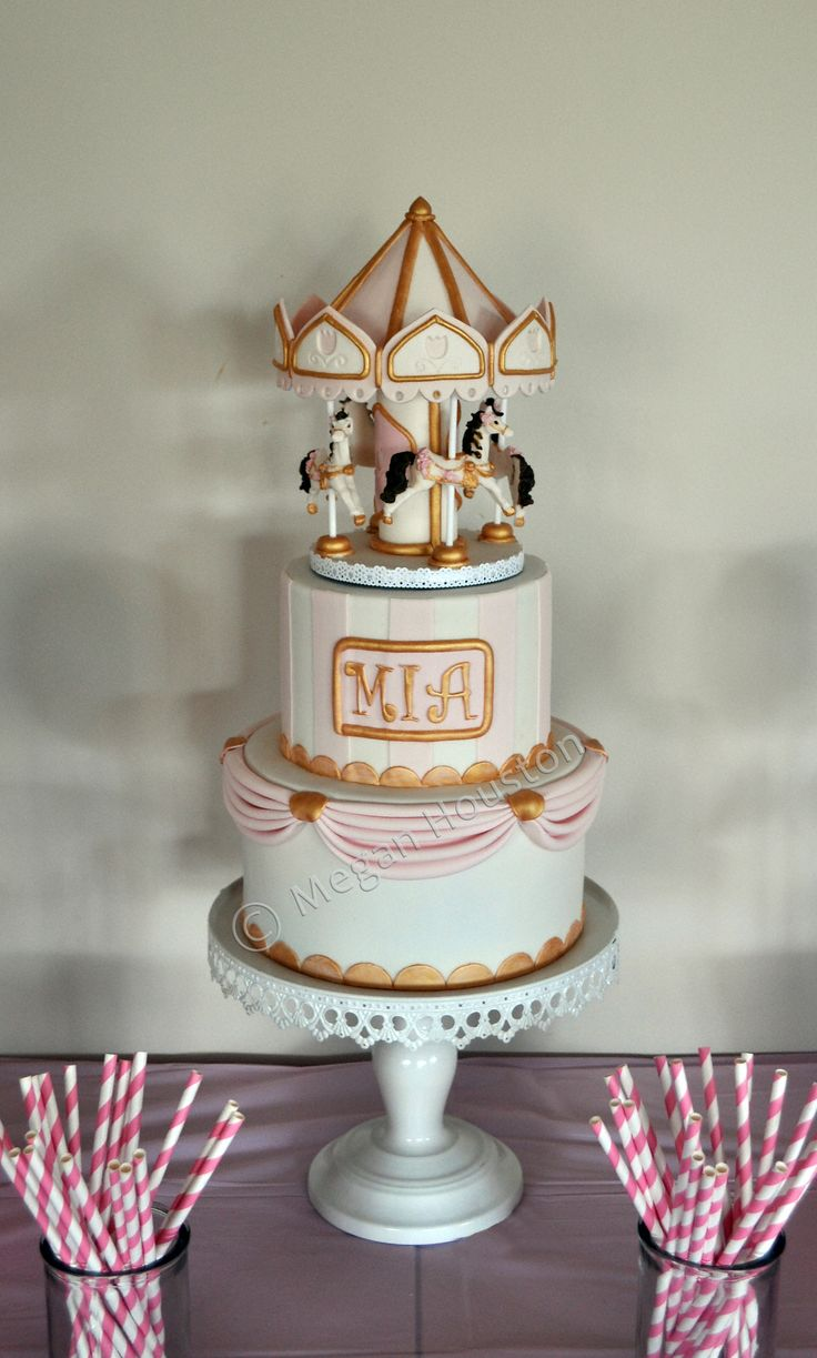 Carousel Cake - I made this carousel cake for my Daughters 1st Birthday. There was a small turntable hidden in the top tier and the Carousel slowly rotated.
