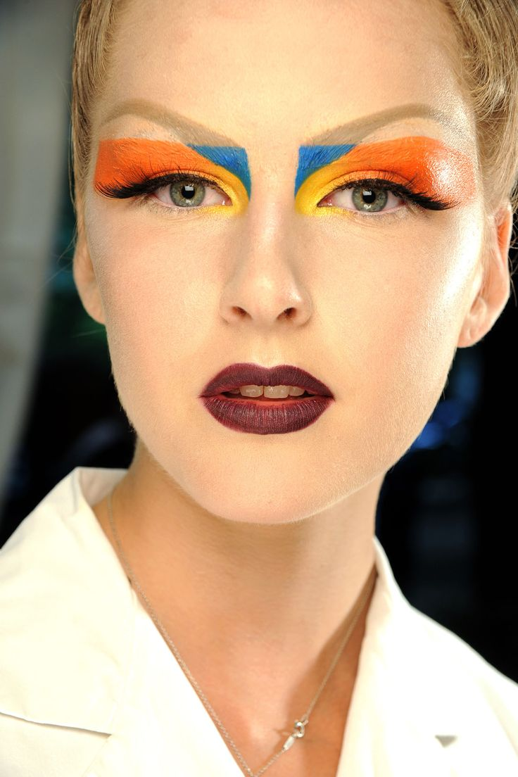 AUTUMN/WINTER 2010-11 COUTURE - Graphic paintbox eyes were complemented by drawn-on arched brows, extra-long lashes and vermilion lips at Christian Dior.