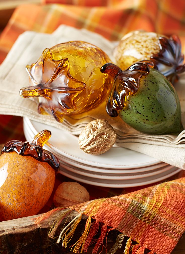 As beautiful and important as they are in nature, acorns deserve to be celebrated with special materials and artistic consideration. Pier 1's assortment is made from beautifully marbled amber, verdigris and java glass, as well as crackled amber glass. Place your collection in a centerpiece or on a mantel or countertop.:
