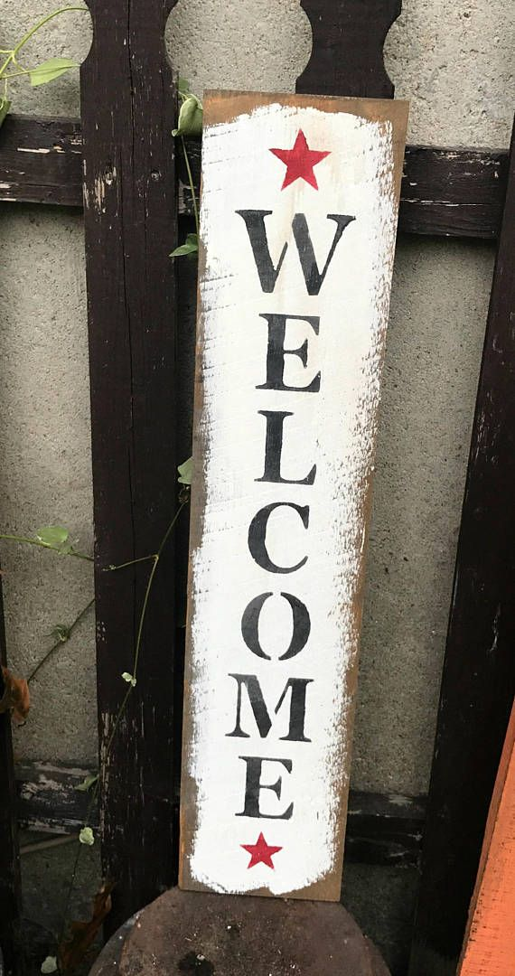 This wooden welcome sign is made from a piece of rough barn wood, and measures Approximately 5.5W x 25L. It reads Welcome. The front is painted with a White Chalk Paint and then stenciled. The back has a router spot for hanging. All of our signs are painted, stenciled, sanded and stained by
