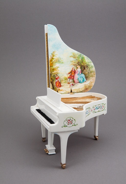 """White 5"""" grand piano with side of the case and underside of lid hand-painted by Jo. Piano handcrafted by Bart Kennedy."""