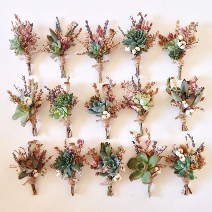 Succulent boutonnieres with dried blooms, berries, and lavender, then wrapped in twine.