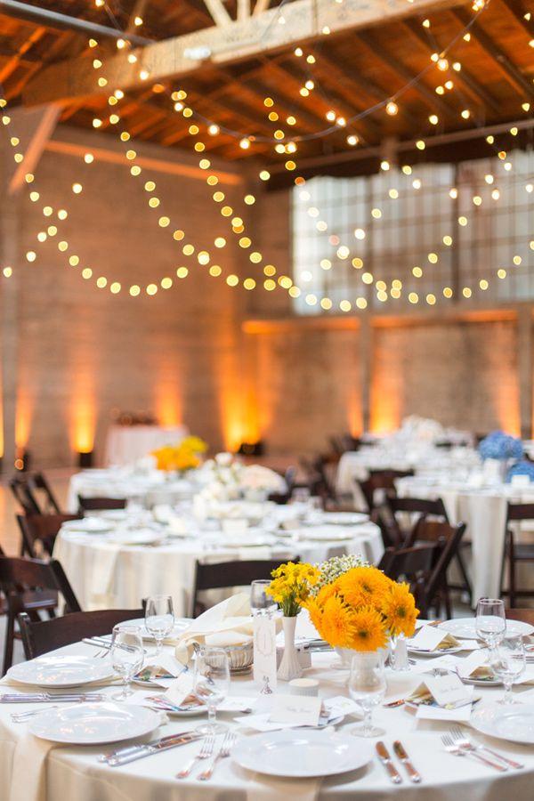 low-hanging twinkle lights, photo by Christina McNeill http://ruffledblog.com/industrial-san-francisco-wedding #reception #lighting
