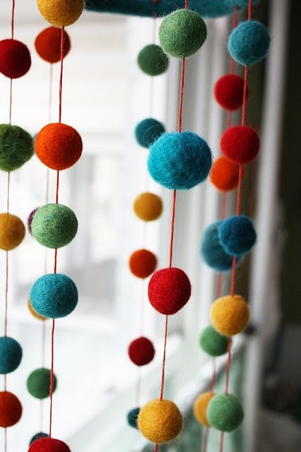 I'm going to use this felting technique to make a cool 'beaded' curtain to divide a room...or mobile!!