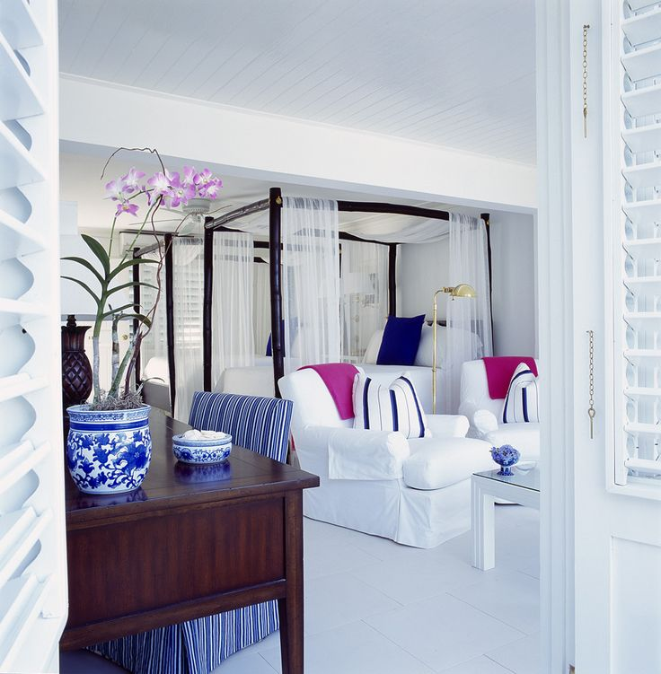 Plantation Shutters | Potted Orchid | White Sofa | Blue White Rooms | Color Palette Ideas | Home Decorating | Interior Design