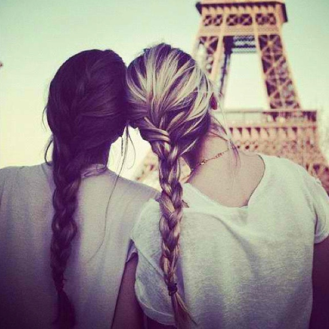 The braids are so cute, with the messy look....and the Eiffel tower in the background makes everything right.. .:)