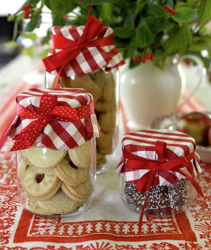 All that holiday baking can actually offer decorating rewards. Fill plain Mason jars with homemade treats and top with festive fabric or paper. Finish off with a grosgrain ribbon for just the right touch.: