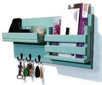 This Mail Holder with shelf features three metal hooks, a single slot for mail, one integrated display shelf with lip to keep electronics secure. It's ideal for entryway organization and perfect for k