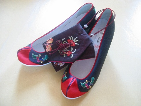 "Hwahye, Traditional Korean Shoes, also called ""flower shoes"" because of their likeness to flower petals. Hwahye shoes were worn by the groom and bride during royal weddings and for other occasions such as days of national mourning. There were many types of Hwahye worn by different types of people according to their age, social class, and gender."