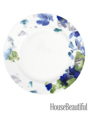 Brushstrokes give the impression of flowers. The pattern on the edge artfully frames whatever you serve.