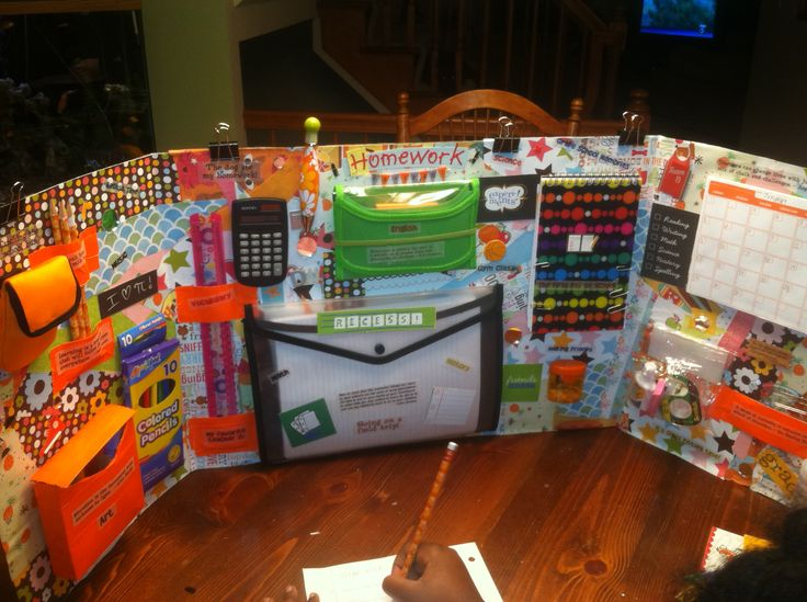 Homework Station:   Science trifold cut in half. Scrapbook paper.  Dollar store…