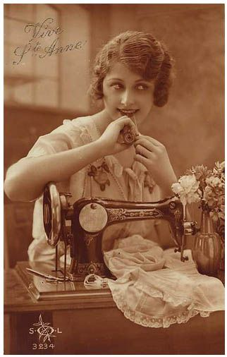 Young woman at sewing machine, c. 1920s.