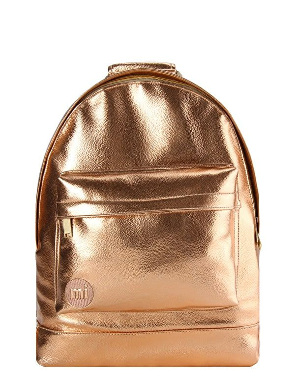 Metallic Rose Gold Back Pack: The Mi-Pac Metallic Backpack in Rose Gold is the perfect travel fashion accessory. A tough and durable faux-leather backpack from the premium Gold range. It features adjustable padded shoulder straps to the back and a top carry handle for versatile wear. It has a zipped front pocket and a large main compartment with an internal padded laptop sleeve.   17L Capacity Water Resistant Padded Laptop Compartment Fully Lined Super Strong Padded Straps Dual Zip Opening…