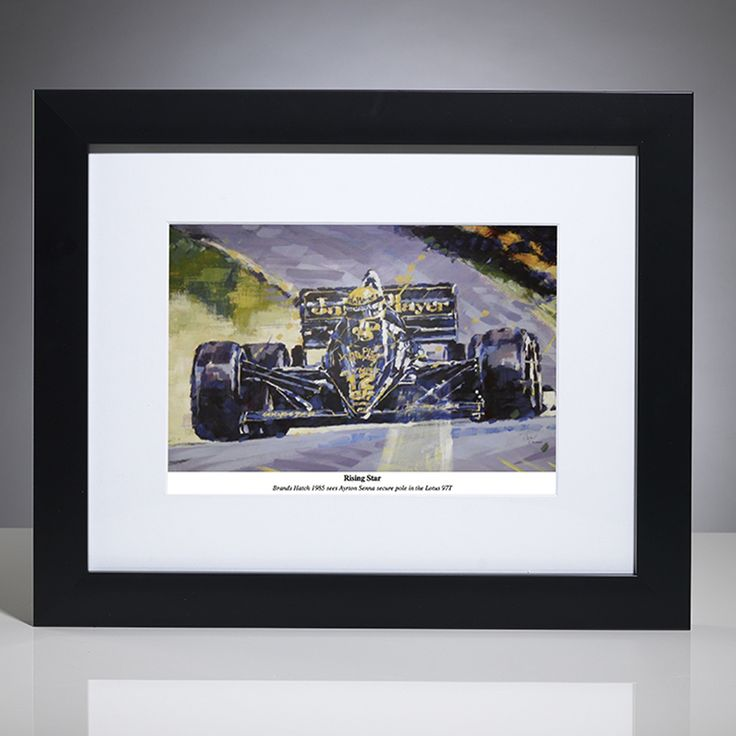 This limited edition F1 art print by British artist, Simon Canacott captures Senna in his early Formula One years; 'the rising star'. In the 1985 European Grand Prix at Brands Hatch, Senna claimed his 6th pole position of the season in his Lotus-Renault with its iconic John Player Special sponsorship.  Limited edition of 500 prints; signed and numbered by the artist. Framed by our professional framing team with a matt black frame and white conservation-grade mount board, pr...