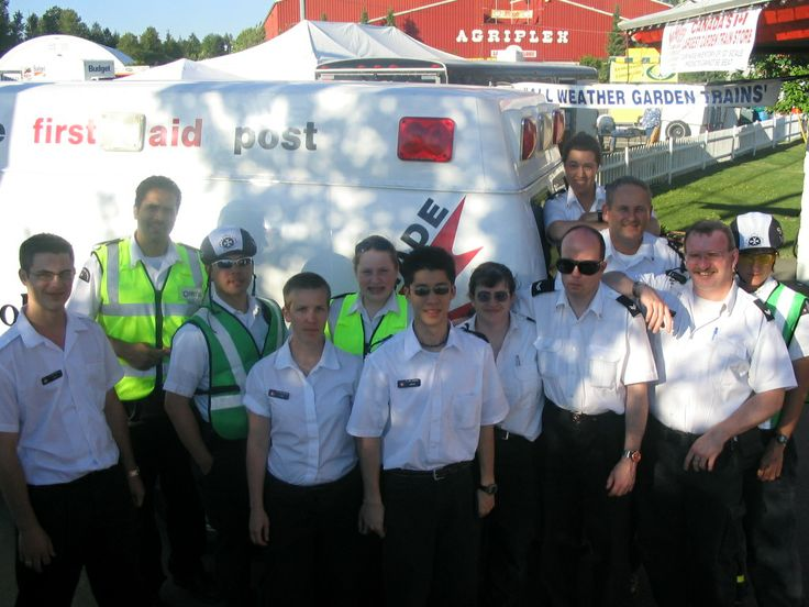 A group of volunteers gathered around a mobile first aid post.