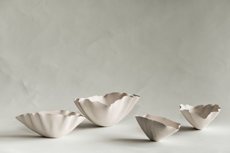 Pottery created using an analog 3D printer…fascinating process, graceful fluid forms.