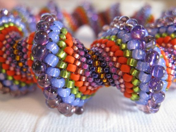 Peyote Stitched Cellini Spiral Bangle off loom by BeadsByTamara, Etsy    Having made one of these bracelets myself, I have to say, $295.00 is about right. Love the color choices!